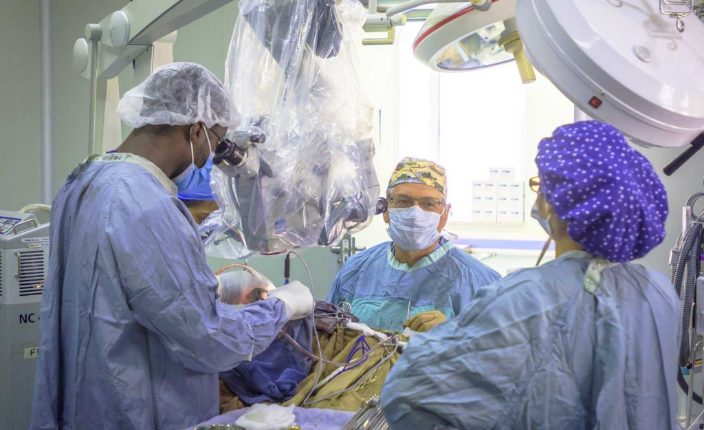 KBNF Neurosurgeons using a neurosurgical microscope, donated from North America, in West Africa